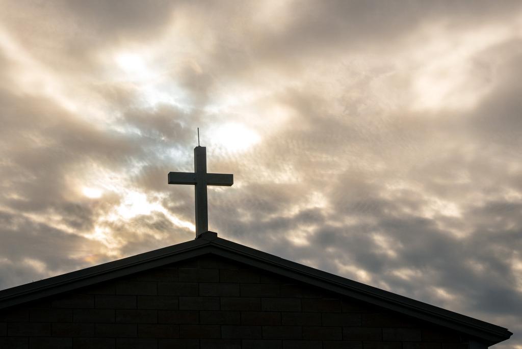A cross adorns Ascension Garden's mausoleum.
