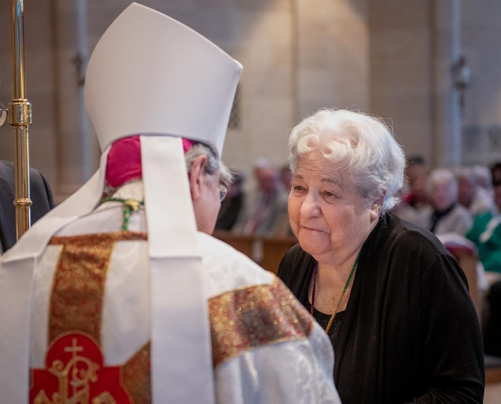 Mary Camobreco, founder and longtime director of Birthright in Ithaca, accepts a Vita Award from Bishop Matano following Mass.