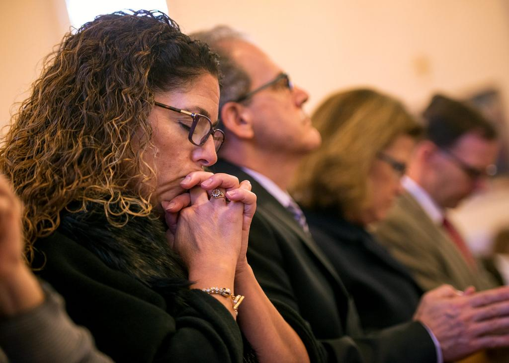 Paula Belemjian prays during the liturgy.