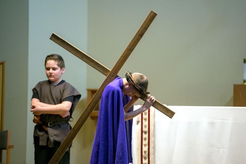 Jesus, played by Ben Dodds, carries his cross.
