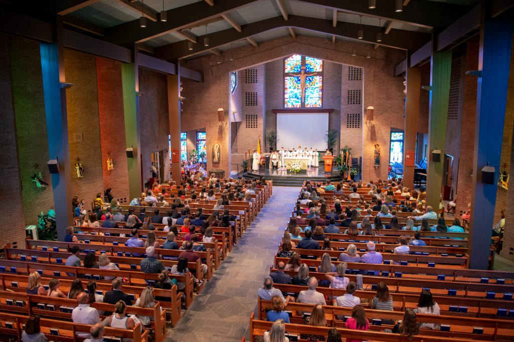 Current and former students and their parents gather in St. Louis Church for the prayer service.