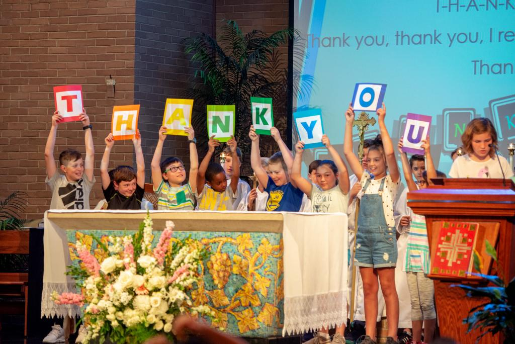St. Louis School students sing a thank you song during the service.
