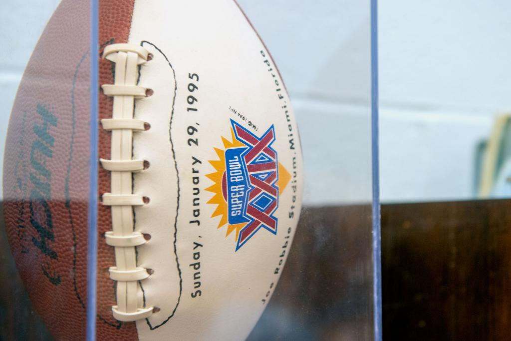 A commemorative football from the 1995 Super Bowl is offered for sale.