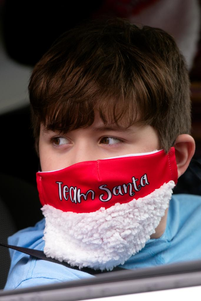 A childwears a holiday-themed mask.