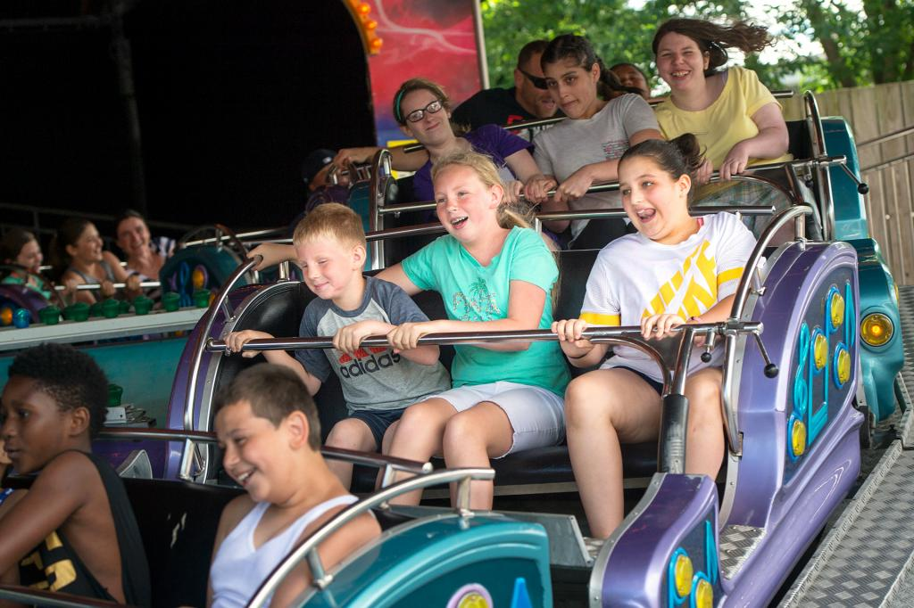 Gideon Mann (from left), Ruairi Mann and Meredith Mattice, students from St. Agnes School in Avon, ride the sled ride at Seabreeze Amusement Park in Irondequoit June 21 during a field trip celebrating the end of the school year.