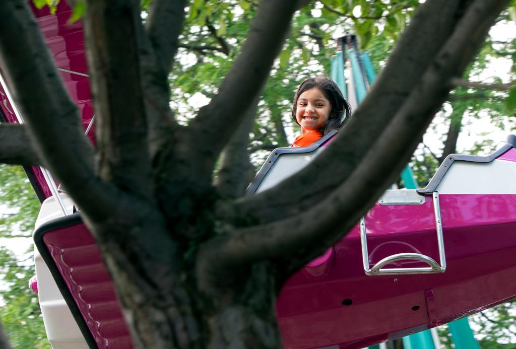 Esperanza Young, a student at Avon's St. Agnes School, rides the plane ride at Seabreeze Amusement Park in Irondequoit June 21 during a field trip celebrating the end of the school year.