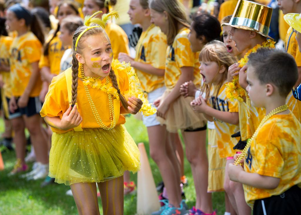 Emma Mathis gives the gold team a pep talk before a tug-of-war contest June 21 at Webster's St. Rita School during the Blue-Gold Day celebrating the end of the school year.
