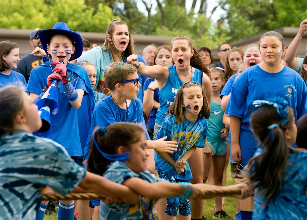 The blue team cheers during a tug-of-war contest June 21 at Webster's St. Rita School. The event was part of a field day that marked the last day of school for the students.