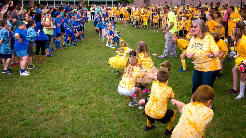 Members of the blue and gold teams face off in a tug-of-war contest June 21 during the Blue-Gold Day celebration at Webster's St. Rita School. The event was part of a field day that marked the last day of school for the students.