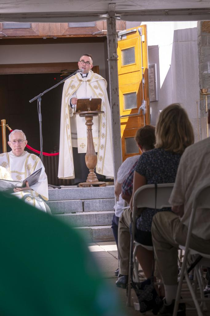 Father Matthew Jones speaks during the closing ceremony. (Courier photo by Jeff Witherow)