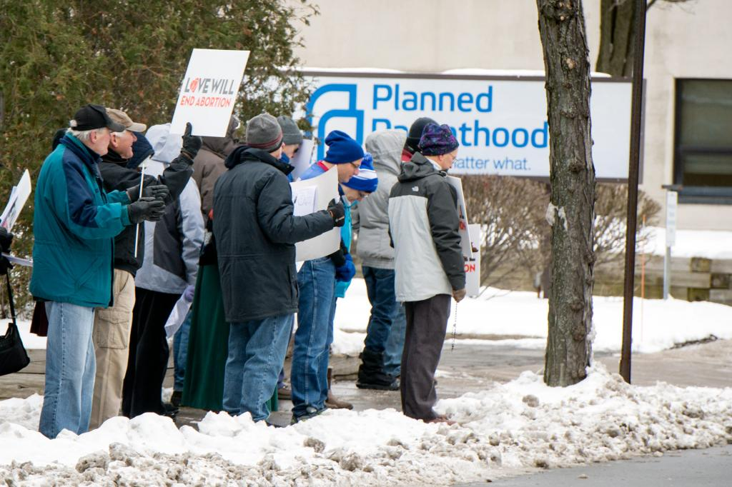 Pro-lifers rally outside of a Planned Parenthood location in Rochester.