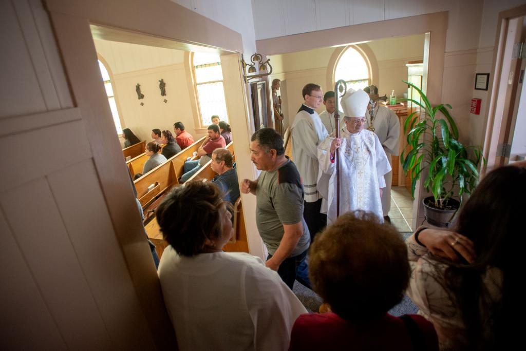 Worshipers enter Our Lady of Guadalupe Mission in Marion for a May 5 Mass with Bishop Salvatore R. Matano.