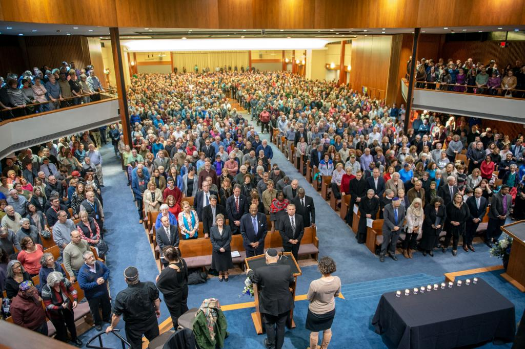 Temple B'rith Kodesh in Brighton overflows with mourners during an Oct. 28 vigil honoring the individuals killed Oct. 27 during a shooting at Tree of Life Synagogue in Pittsburgh.