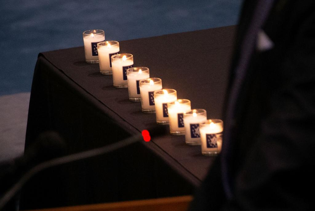 Candles lit near the altar memorialize the 11 individuals who lost their lives during the synagogue shooting.