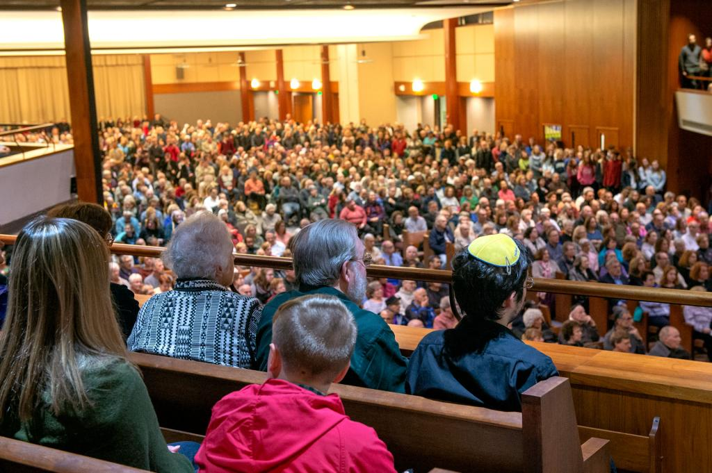 An estimated 2,000 people filled Temple B'rith Kodesh for the vigil.