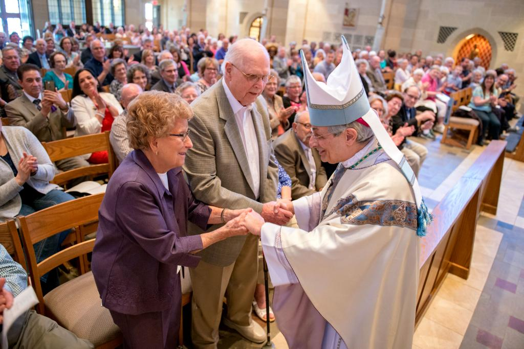 Bishop Salvatore R. Matano congratulates Anthony and Josephine Matroniano on their 71 years of marriage during the annual Wedding Jubilee Mass May 6 at Rochester's Sacred Heart Cathedral.