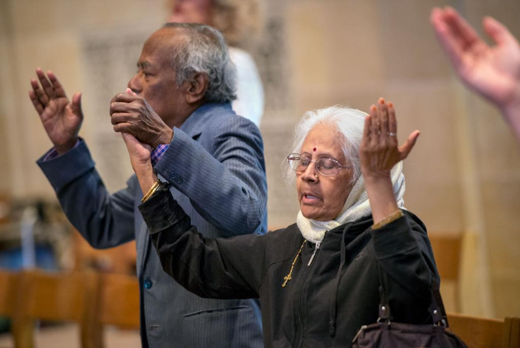 Isabella and Thiagaraj Nevis, who are celebrating 50 years of marriage, stand during the liturgy.