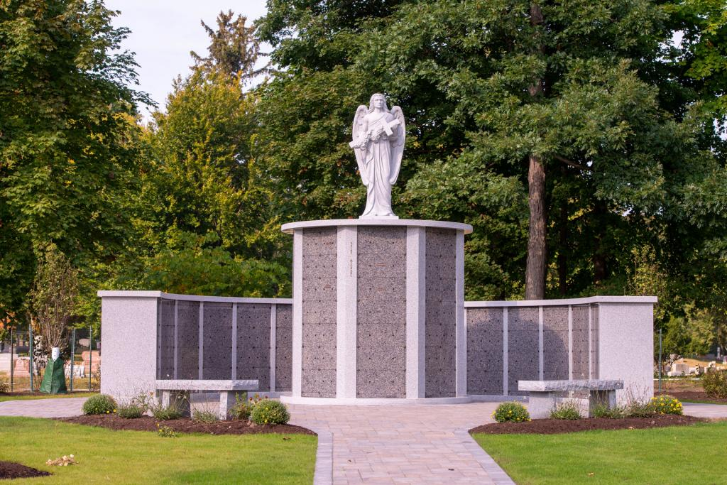 A statue of the archangel Michael adorns the top of one of the garden's three columbaria.