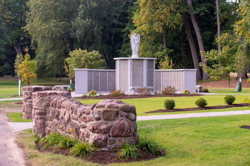 A statue of the archangel Raphael stands atop columbaria.