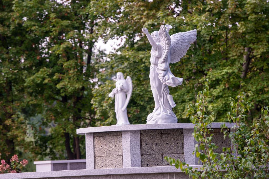 Statues of the archangels Gabriel and Michael are seen at the garden.