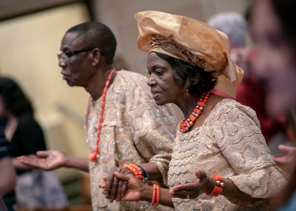 Beatrice and Emmanuel Oparah, who are celebrating 50 years of marriage, stand during the liturgy.
