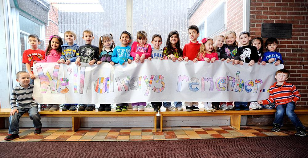 Kindergartners hold a banner they made for the fire dept.