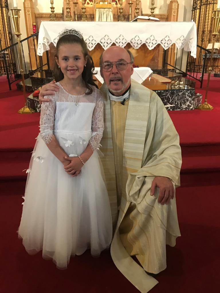 Madeline (left) with Father Stan  Kacprzak, Pastor at Our Lady of Valley Parish in Hornell/Rexville. Madeline received her First Holy Communion at St. Ann Church in Hornell. (Submitted by mom, Mary)