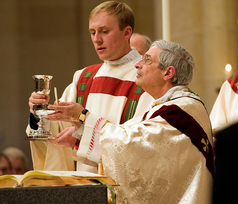 Deacon Peter Van Lieshout assists Bishop Matano as he celebrates the Eucharist.