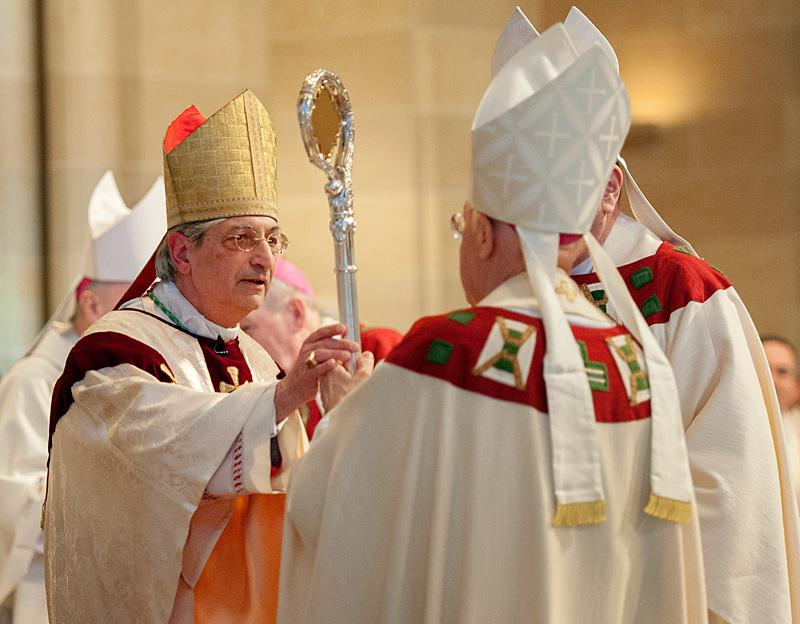 Archbishop Carlo Maria Viganó, Papal Nuncio to the United States, hands Bishop Matano his crosier.