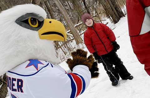Nine-year-old Teagan McKane meets Amerks mascot 'R. Thunder.'