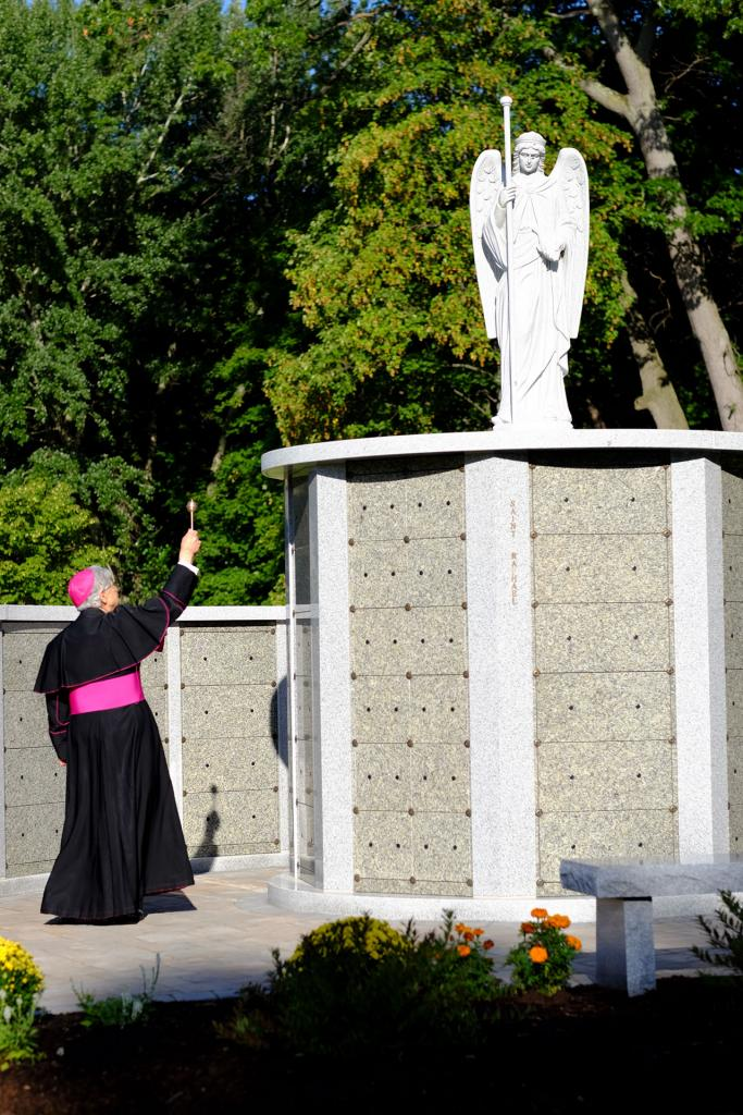 Bishop Matano blesses columbaria depicting the archangel Raphael. (Photo courtesy of Holy Sepulchre Cemetery)