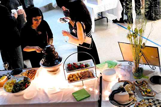 People sample desserts during the BLAST fundraiser March 20.