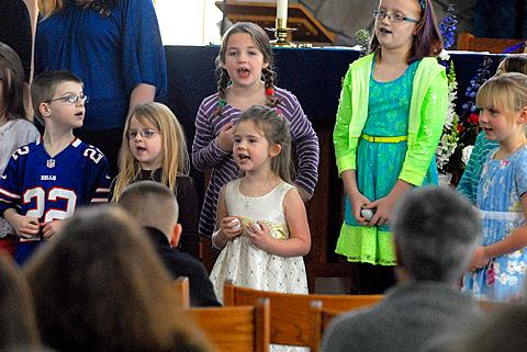 Members of the children's choir perform.