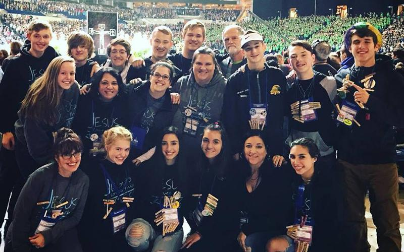 Youth and chaperones from St. Christopher Church in North Chili pose for a photo at Lucas Oil Stadium in Indianapolis. (Photo courtesy of St. Christopher Church)