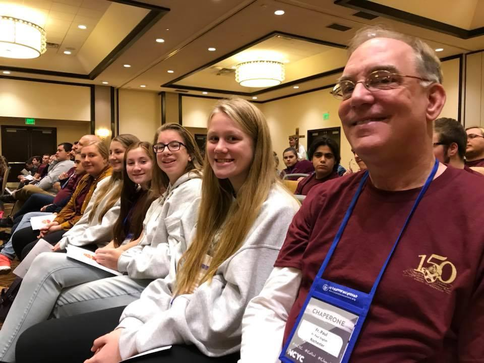Father Paul English and the teens from St. Kateri Tekakwitha Parish at the opening diocesan Mass Nov.16. (Photo courtesy St. Kateri Tekakwitha Parish)