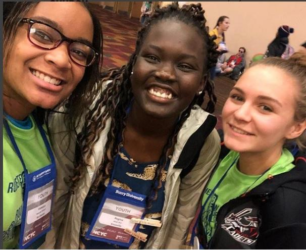 Teens from St. Monica Church in Rochester take a photo with youth speaker Regina Wol. (Photo courtesy St. Monica Church)