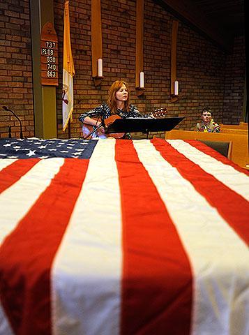 Music teacher Sarah Wilke plays the guitar.