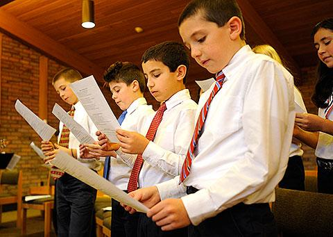 Students sing during the service.