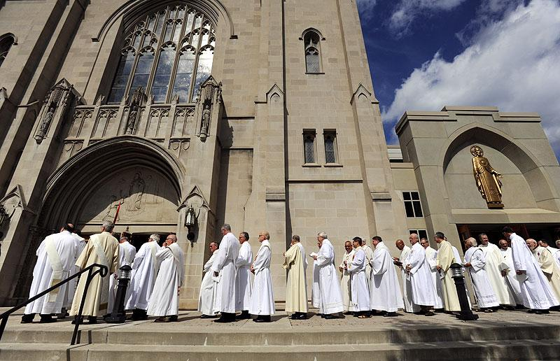 Clergy wait to process into Sacred Heart Cathedral.