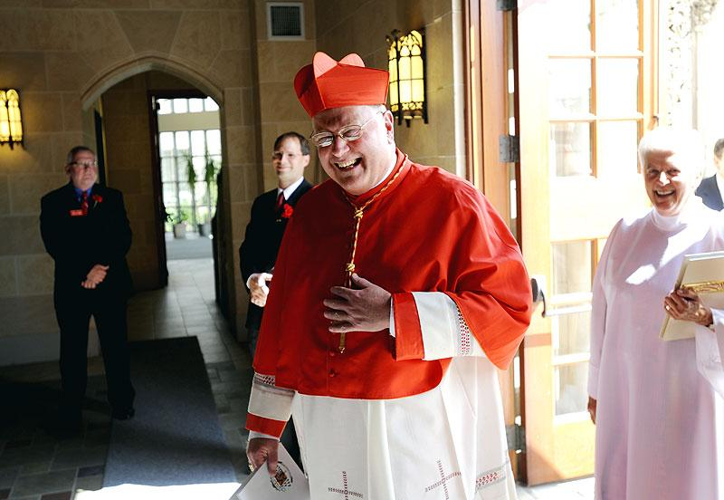 Cardinal Dolan processes into Sacred Heart Cathedral.