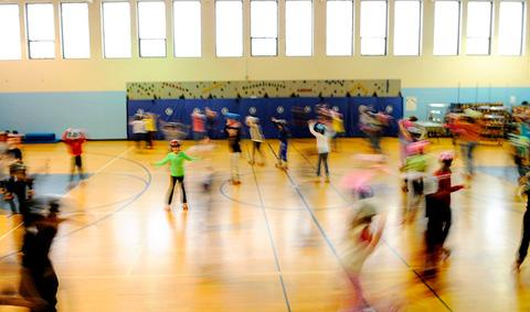 Students speed around the gym at St. Lawrence School.