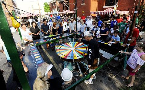 Festival-goers play games of chance.