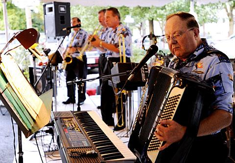 Ray Serafin (right) and band Brass Magic play polka music.