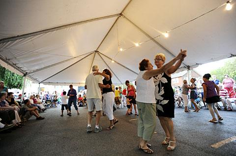Festival-goers dance the polka.