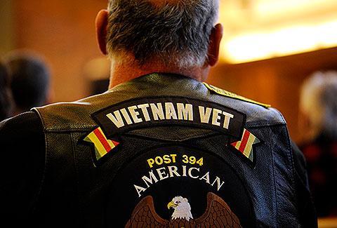 U.S. Navy veteran Paul Goodell sits in church.