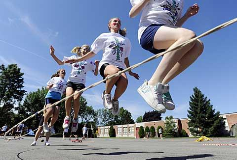 Katie Kruppenbacher, Emma Beach and Ally Bianchi jump rope.