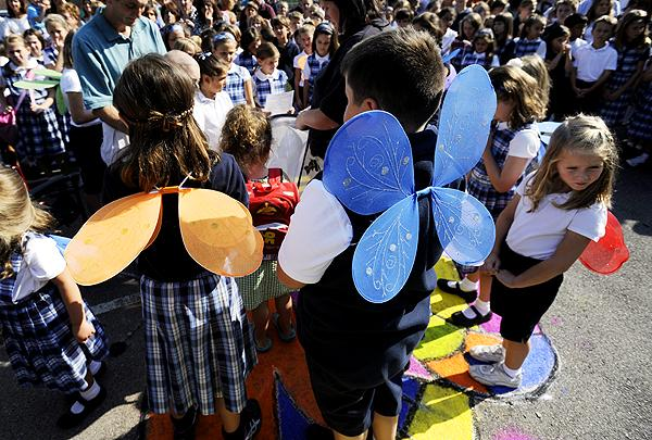 Some students wore wings during the butterfly release.