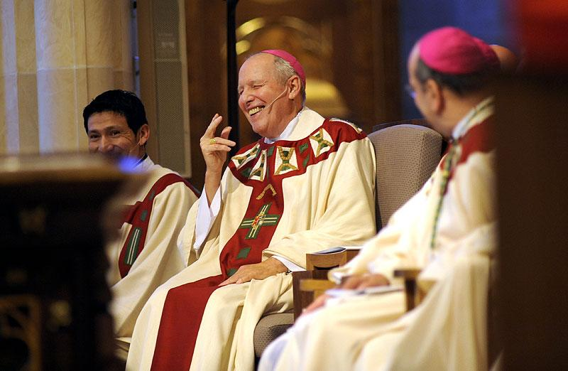 Bishop Clark reacts to a joke by Cardinal Dolan.