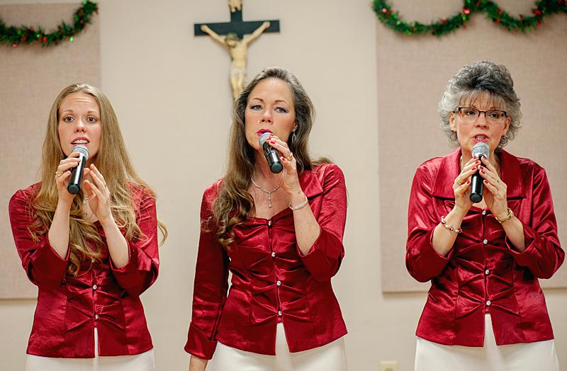 Lacy Burdick (from left), Pam Warren and Pam Sandberg, members of the singing group Final Harvest, perform during the Creche Festival.