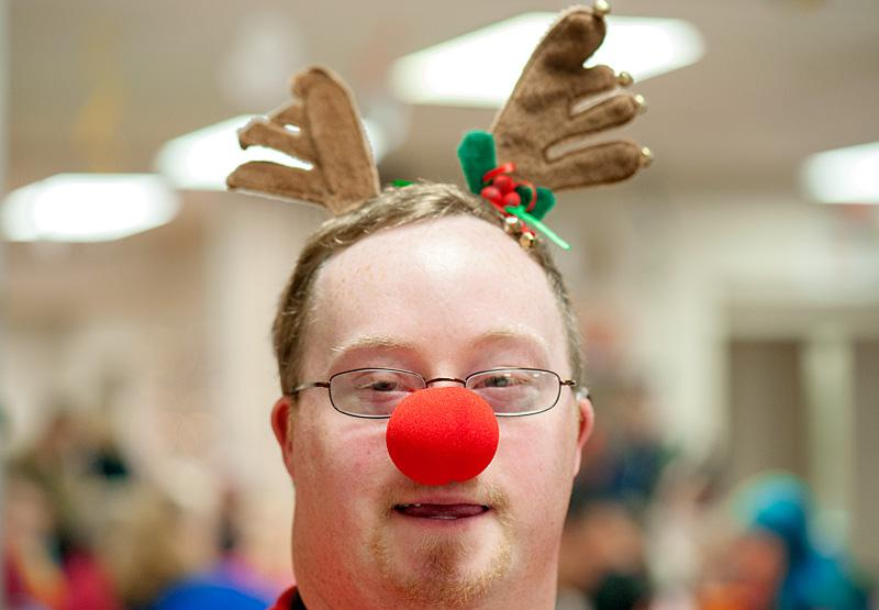 John Himmelsbach shows off his Rudolph nose during the Creche Festival's breakfast with Santa and St. Nicholas Dec. 7.
